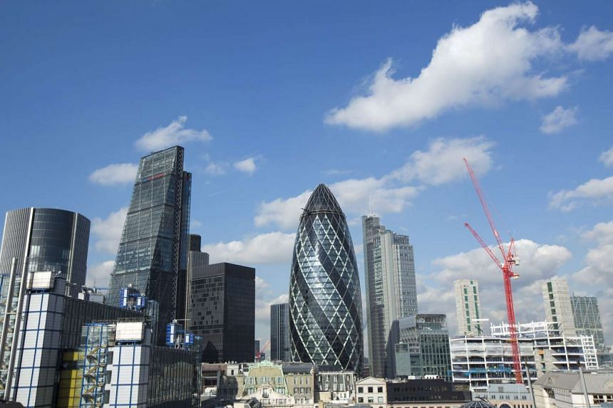 Skyscrapers including the Leadenhall building stand surrounded by commercial office buildings in the City of London.