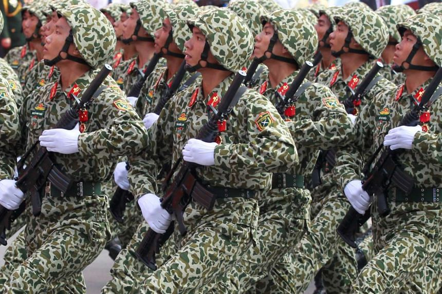 Soldiers hold rifles while marching during a celebration to mark Reunification Day in Ho Chi Minh city, Vietnam, on April 30, 2015.