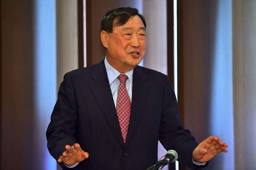 Former South Korean commerce minister Lee Hee Beom speaks to the media after a general assembly of the PyeongChang 2018 Organizing Committee.