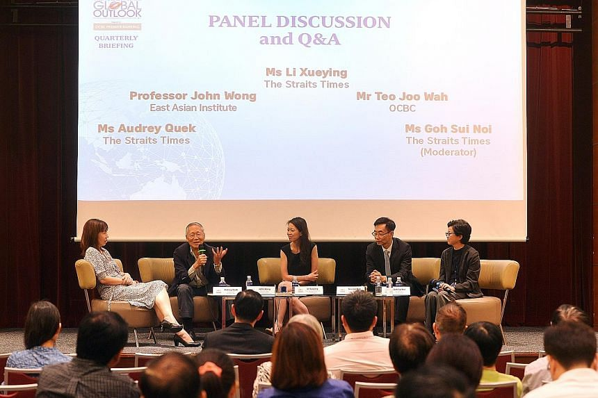 Prof Wong (second from left) speaking during the panel discussion yesterday. The other panellists were (from left) ST's foreign editor Audrey Quek, ST's senior regional correspondent Li Xueying and Mr Teo Joo Wah, chief strategist with OCBC Group's L