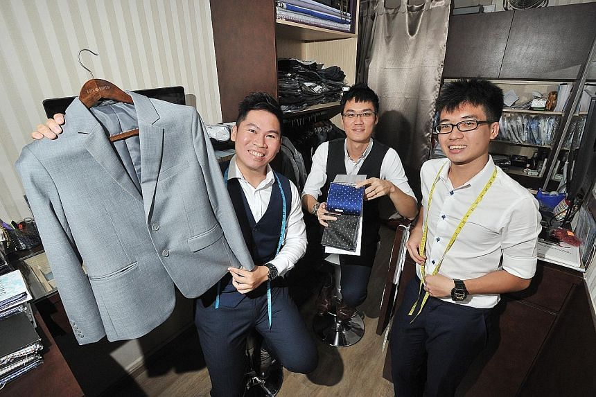 From left: Este Bartin's co-founders Barry Lim and Justin Loy with their tailoring assistant Benedict Teo. There are plans for another store, also in a heartland area.