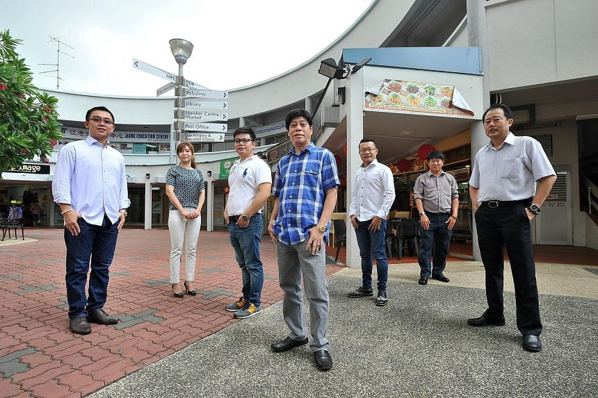 Members of the Ang Mo Kio Constituency Merchants Association (from left) Mr Ho Kim Long, 40, vice-secretary; Ms Gao Zhiying, 40; Mr Xu Guochang, 38; Mr Peter Lai, 65, president; Mr Mark Lim Boon Wei, 31, relationship officer; Mr Lim Kok Yong, 50, tre