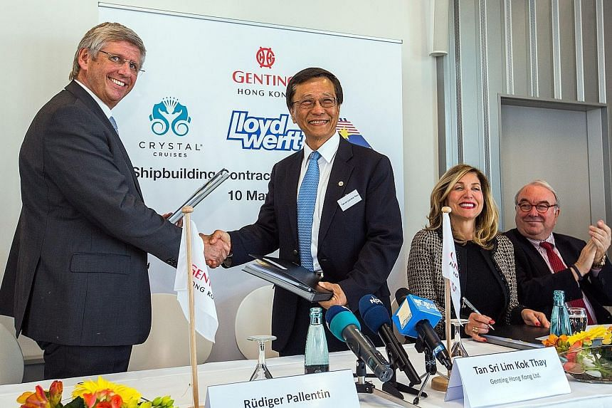 "Mr Lim, Genting Hong Kong chairman, with Lloyd Werft Group CEO Ruediger Pallentin (left) in Germany on Tuesday. Deals were signed for the construction of several cruise vessels, including two ""global class"" ships (such as the one in the photo)."