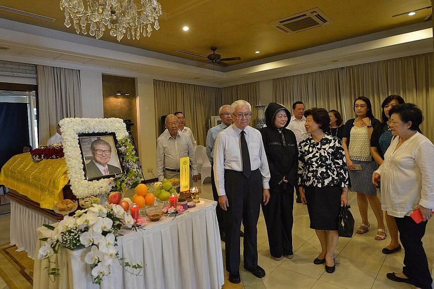 President Tony Tan Keng Yam and his wife Mary Tan were among those who paid their respects to Mr Lee at his family home yesterday. With them is Mr Lee's wife Della Susantio Lee.