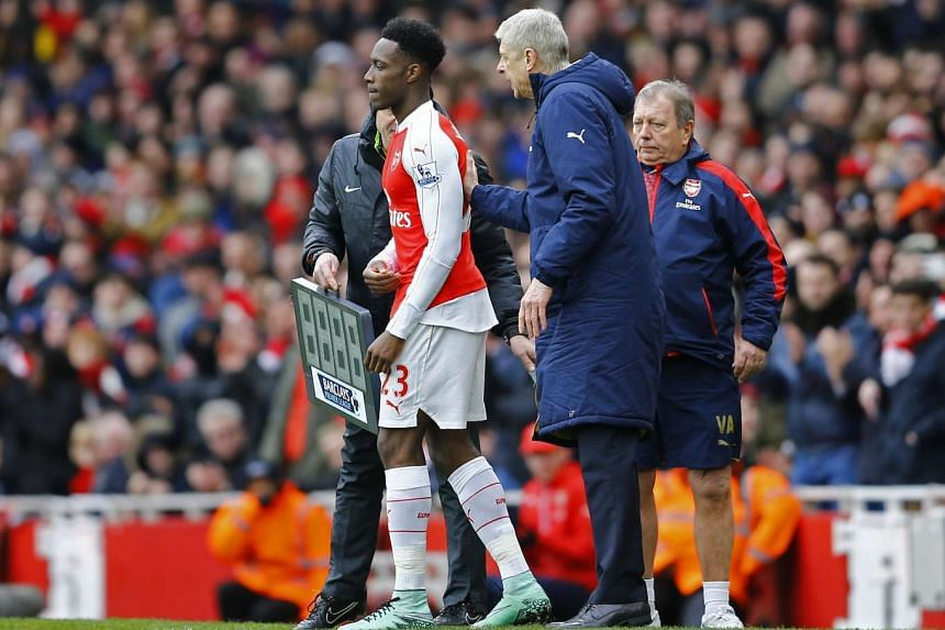 Arsenal manager Arsene Wenger with Danny Welbeck in February 2016.