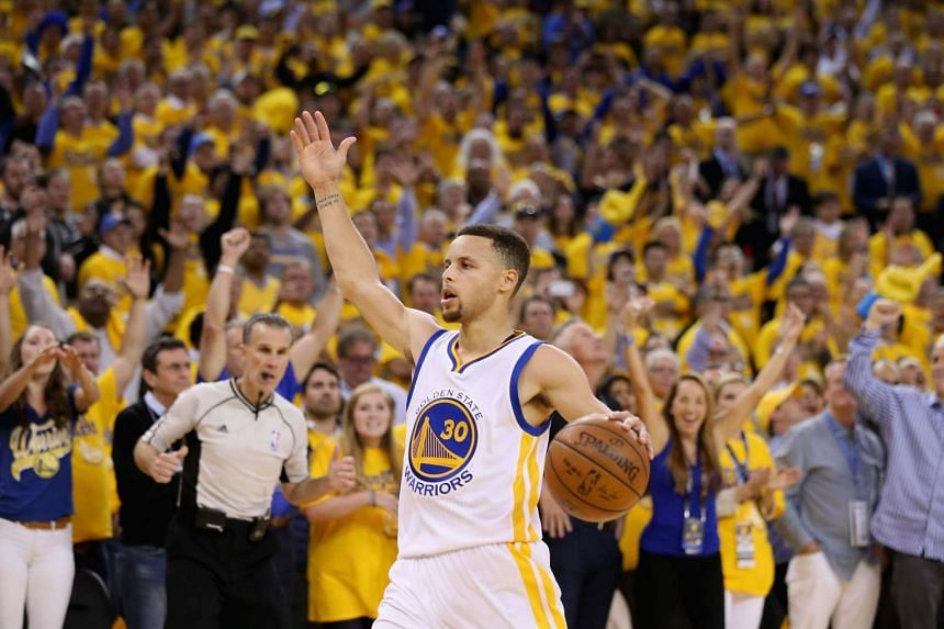 Stephen Curry #30 of the Golden State Warriors runs down court during the finals seconds of their win over the Portland Trail Blazers.
