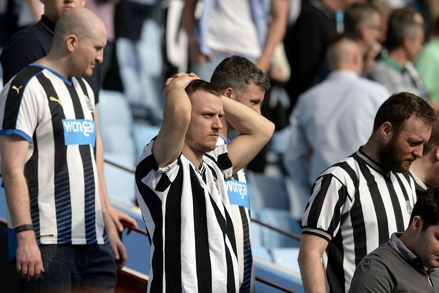 Newcastle fans look dejected after the English Premier League match between Newcastle United and Aston Villa.