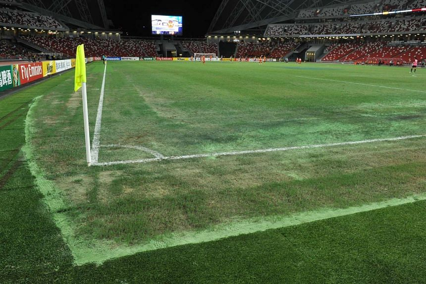 Sections of the National Stadium pitch appeared to be sandy during the Asian Football Confederation football match between Tampines Rovers and Selangor.