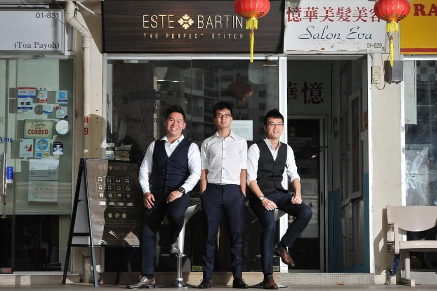 Owners of tailor shop Este Bartin, Justin Loy (right), 33, and Barry Lim (left) , 35, together with their employee, Benedict Teo (center), 23, at their boutique in Toa Payoh.