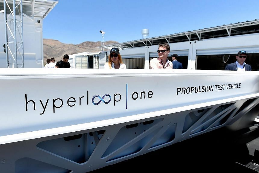 People look at a demostration test sled after the first test of the propulsion system at the Hyperloop One Test and Safety site on May 11, 2016 in North Las Vegas, Nevada.