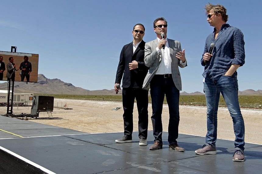 Shervin Pishevar (left) co-founder and Executive Chairman, Rob Lloyd (centre) CEO, and Brogan BamBrogan (right) co-founder and CTO with Hyperloop One talk about the first test of the propulsion system at the Hyperloop One Test and Safety site on May