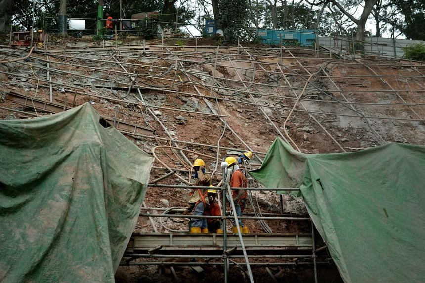 Construction workers at work. Companies will face stiffer penalties if found lacking in workplace safety and health standards, the MOM announced on May 12.