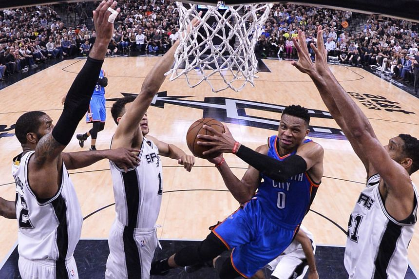 Oklahoma City Thunder player Russell Westbrook (centre) going to the basket in the first half against the San Antonio Spurs on Tuesday. The 27-year-old, through his unmatched competitive spirit and force of will, sparked the Thunder in the second half to