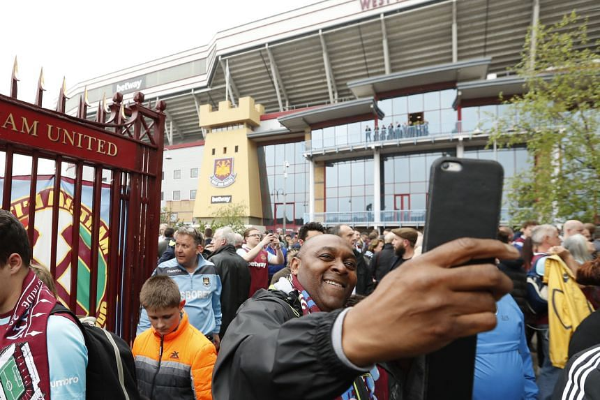A West Ham fan takes a selfie outside Upton Park, before the elaborate commemorative celebrations drew down the final curtain on 112 years of football at the historic venue.