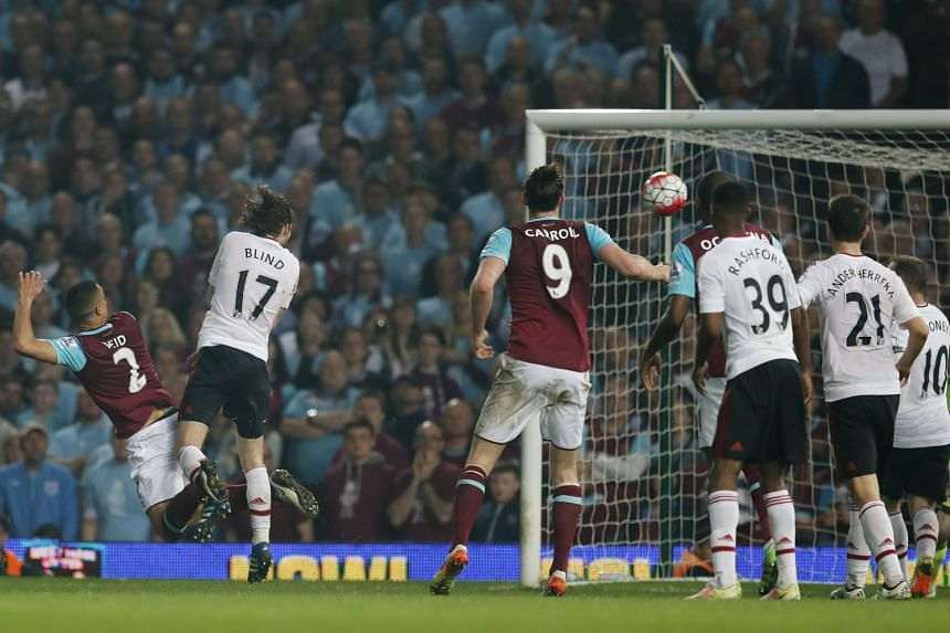 Winston Reid (left) scores the third goal for West Ham, sealing a 3-2 victory against Manchester United on Tuesday. It was the last goal to be scored at Upton Park.