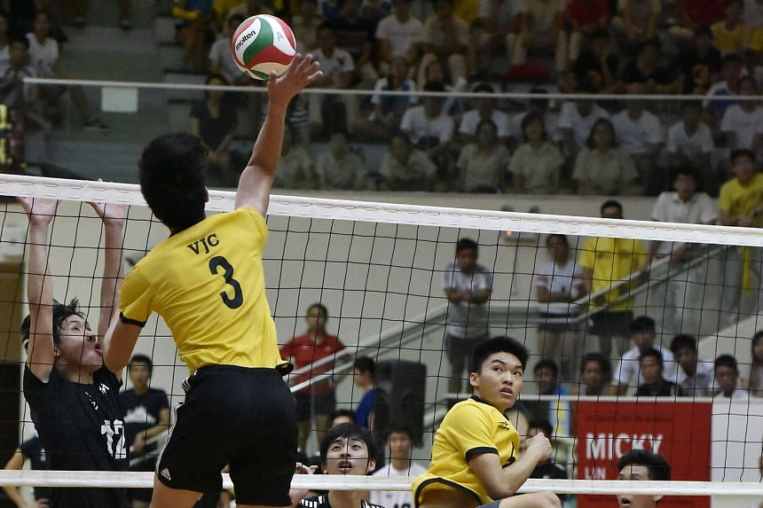 (Above)Victoria Junior College's Phoon Zhen Bang effecting a smash in the boys' final against Nanyang Junior College, who failed to wrest the title from VJC.