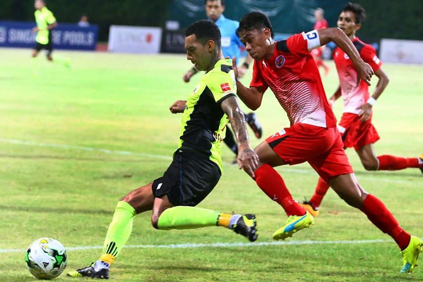 Tampines Rovers' Jermaine Pennant (left) in action with Home United captain Juma'at Jantan during their S-League encounter at the Bishan Stadium on March 3, 2016.
