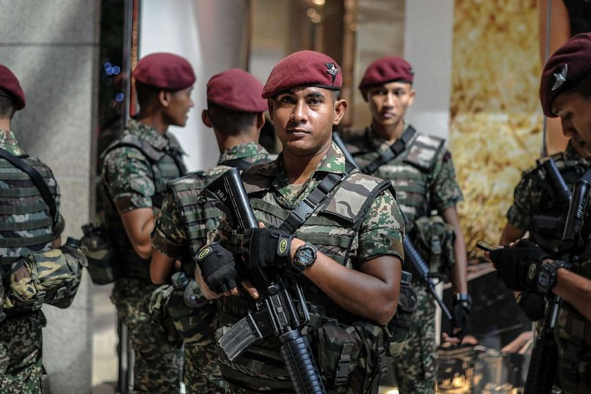 A Malaysian soldier from the 10th Paratrooper Brigade looks on before a joint police-army exercise at a shopping mall in Kuala Lumpur, on Feb 22, 2016.
