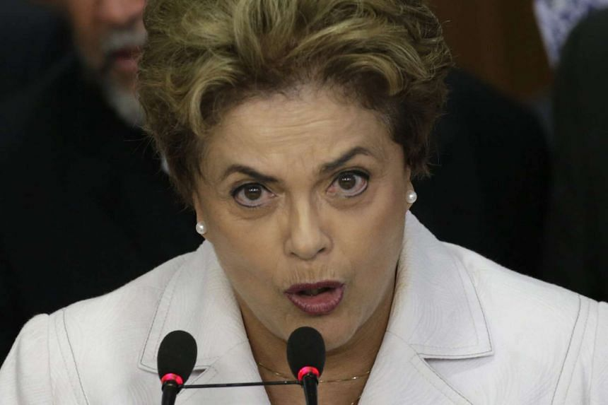 Brazilian President Dilma Rousseff speaking alongside members of her Cabinet, at the Planalto Palace, in Brasilia, Brazil, on May 12, 2016. Vice-President Michel Temer will become Brazil's acting president on May 12 after the Senate voted to remove M