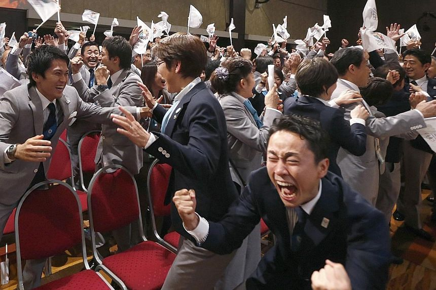 Members of the Tokyo bid committee celebrate as Jacques Rogge, president of the International Olympic Committee, announces Tokyo as the city to host the 2020 Summer Olympic Games during a ceremony in Buenos Aires in 2013.