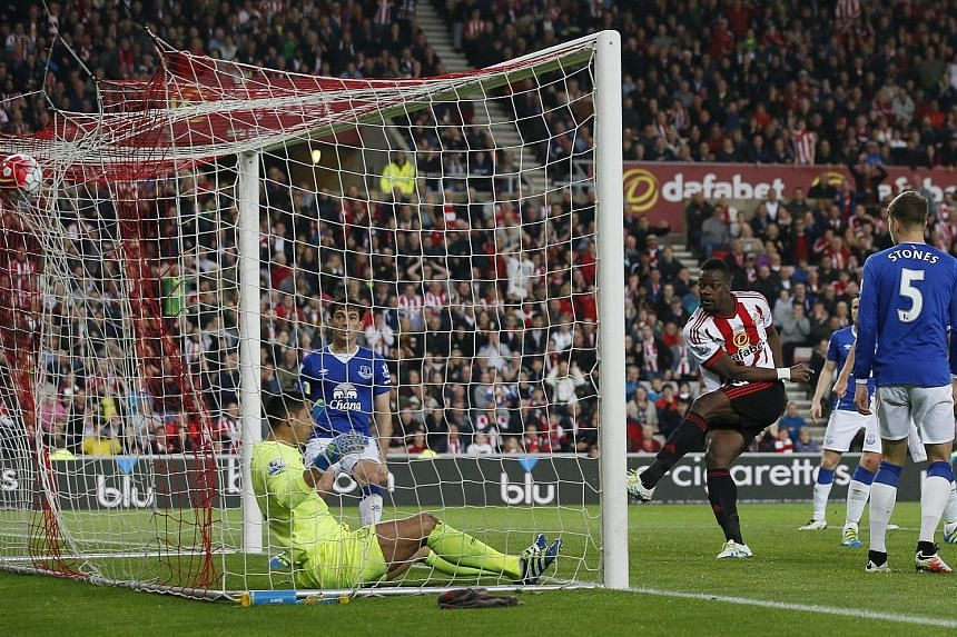 Lamine Kone (left) scores the third goal for Sunderland in their 3-0 win, which secured their escape from relegation.