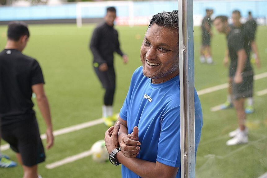 Tampines Rovers coach Sundram is all smiles at a training session with his team at the Jalan Besar Stadium. He has emerged as one of the front runners for the national job vacated by Bernd Stange last month.