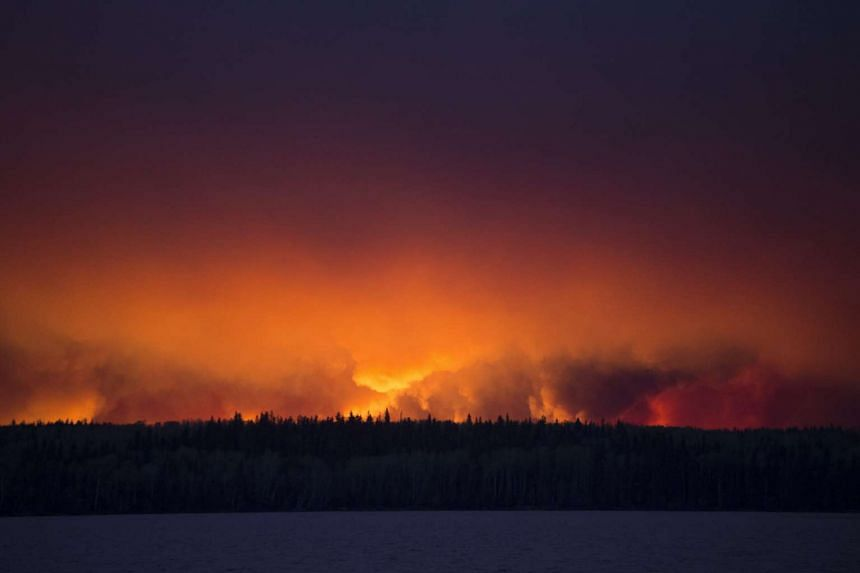 A massive wildfire raging near Anzac, 48km south-west of Fort McMurray, Alberta, Canada, on May 4, 2016.