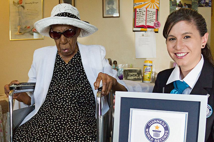 The world's oldest living person Susannah Mushatt Jones (left) is pictured here with Guinness World Records adjudicator Kimberly Patrick on her 116th birthday, on July 6, 2015.