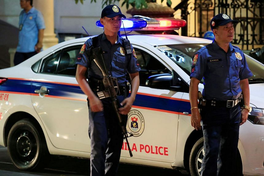 Members of the Philippine National Police (PNP) standing guard along a main street of metro Manila in the Philippines on May 12, 2016.