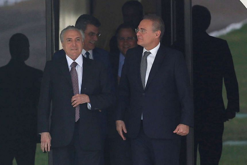 Temer (left) talks with president of the Brazilian Senate Renan Calheiros on May 10, 2016.