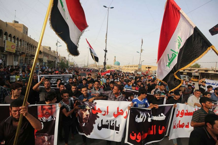 Supporters of Iraqi Shi'ite cleric Moqtada Sadr protest in Baghdad's northern Shi'ite neighbourhood of Sadr City.