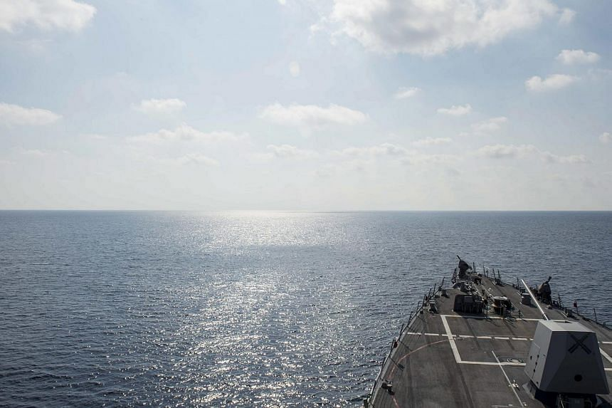 A handout picture made available by the US Ministry of Defence (MOD) on May 10, 2016, shows the guided-missile destroyer USS William P. Lawrence (DDG 110) conducting a routine patrol in international waters in the South China Sea, on May 2, 2016.