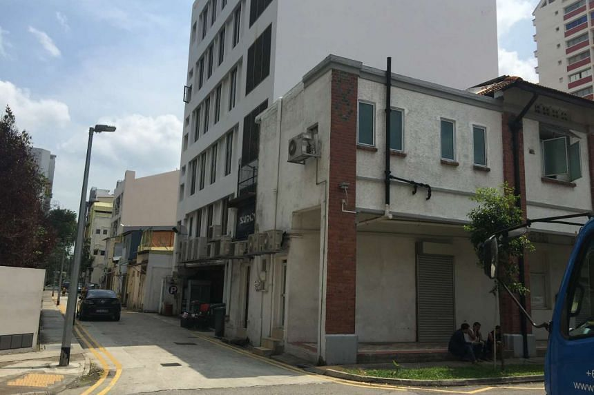 The existing development consists of a two-storey shophouse and an attic, is accessible via an external staircase to the upper floor.