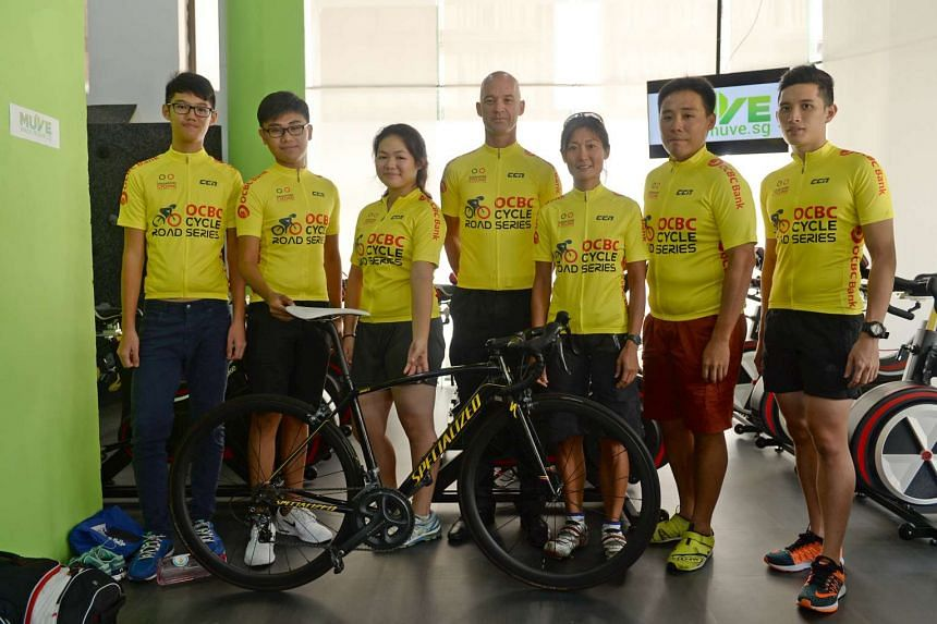 Race winners awarded yellow jerseys: Winners of the first OCBC Cycle Road Race posing with their yellow jerseys yesterday. From left: Lin Kai Hong, Firoz Loh Ridwan Loh, Ashely Jenna Lui, Paul Cummings, Wendy Yap, Foong Wei Sheng and Lionel Boey will