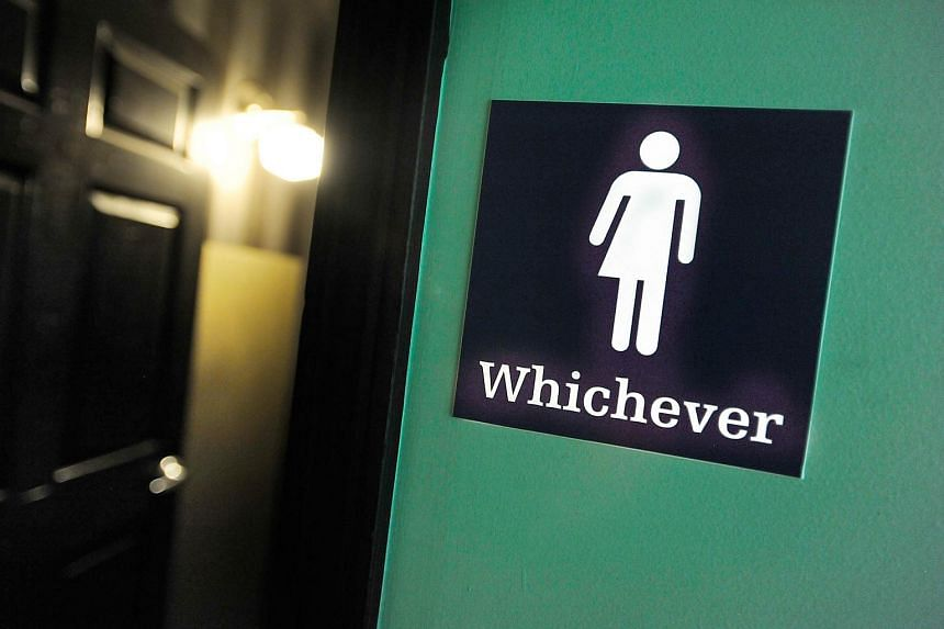 A gender neutral sign outside a bathroom at Oval Park Grill in Durham, North Carolina, on May 11.