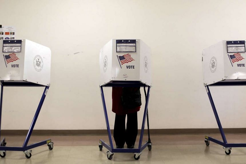 A voter is seen at a polling station during the New York primary elections in Manhattan on April 19, 2016.