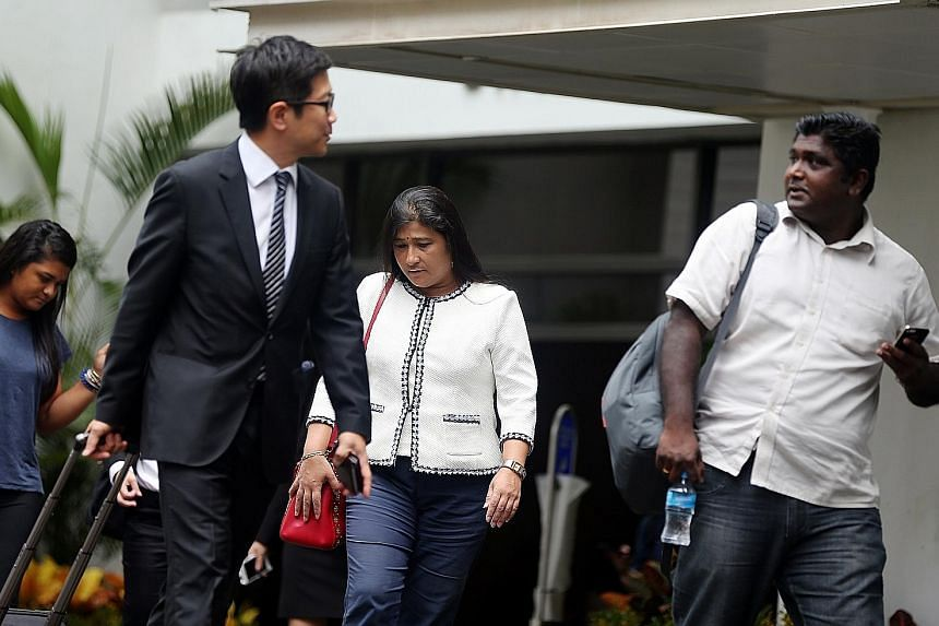 (From left) Gallop Stable's lawyer Simon Tan, owner Mani Shanker and operations director Thanabalan A. Rengasamy outside the court yesterday, the third day of the company's trial on a charge of animal cruelty.