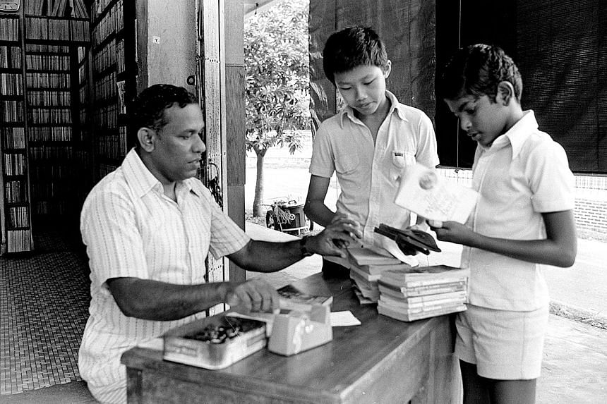Mr Haja Maideen of second-hand bookshop N.I.B. selling books to students, which they could return for a partial refund.