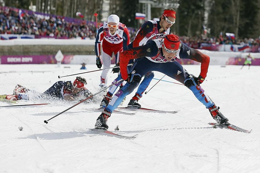 """Russia's Alexander Legkov crossing the line first in the 50km mass start at the Sochi Winter Olympics. He was allegedly among those aided by Russia's doping programme. He has since described those allegations as """"nonsense and slanderous""""."""