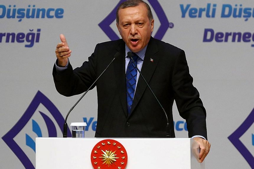 Mr Erdogan speaking at an event in Ankara this week. The promise of visa-free travel is a key pillar of a March accord for Turkey to stem the flow of migrants to the EU, and that could now also be in peril.