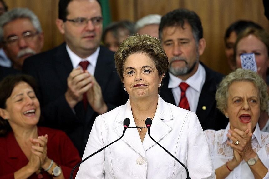 """Mrs Rousseff (left) used her final minutes in the presidency to denounce the """"coup"""" and urge supporters to mobilise as she braced herself for an impeachment trial. Mr Temer (above) wasted no time in putting his stamp on Brazil."""