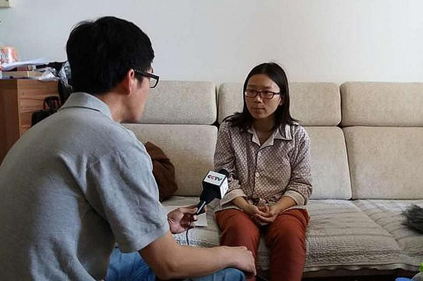 Mr Lei's wife, who gave birth to the couple's first child last month, speaking to the media in an undated photo.