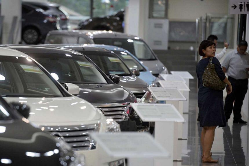 Customers at Tan Chong Motor showroom, a distributor for Nissan cars, on Jan 6, 2016.