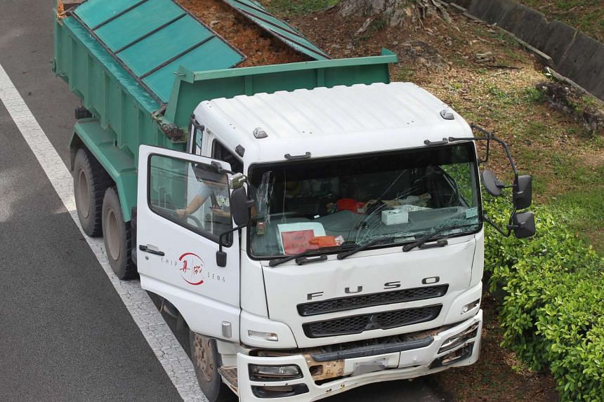 A van, a prison vehicle and a lorry carrying gravel were in a crash on the Pan-Island Expressway on May 13, 2016.