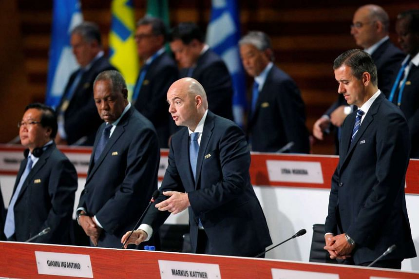 Fifa president Gianni Infantino (centre) speaks during the 66th Fifa Congress in Mexico City on May 13, 2016.