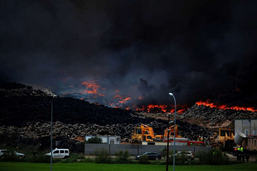 A toxic cloud rises from the huge pile of burning tyres on May 13, 2016.