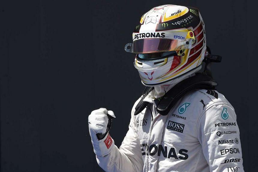 Hamilton celebrates after the qualifying session.