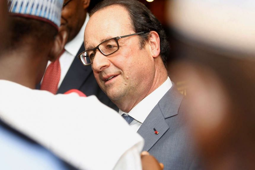 French President Francois Hollande arrives in Abuja, Nigeria, on May 13, 2016.