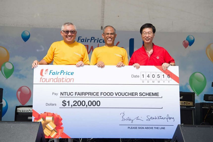 (From left to right) Mr Bobby Chin, Mr Masagos Zulkifli, and Mr Ang Hak Seng at the donation of $1.2 million from NTUC FairPrice to the FairPrice Food Voucher Scheme, on May 14, 2016.