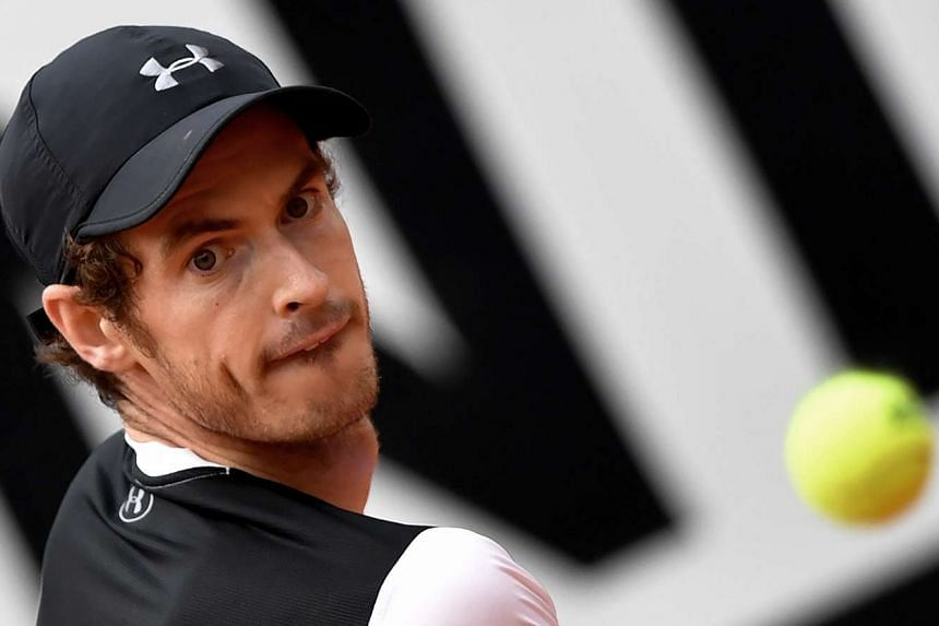 Murray eyes the ball during the ATP Tennis Open tournament semi-final at the Foro Italico on May 14, 2016.